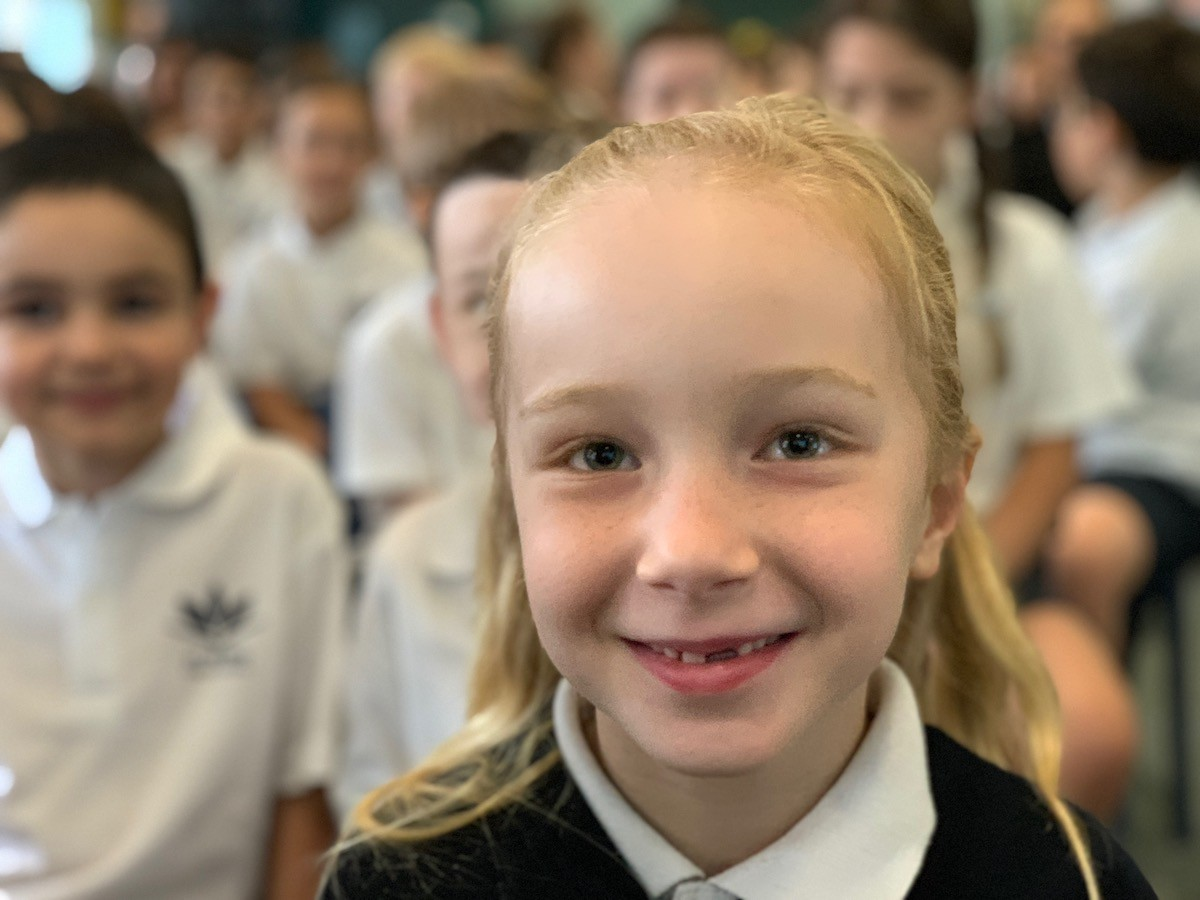 Student smiling at the 2018 Presentation Day