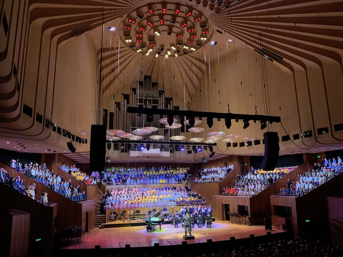 Students in the Sydney Opera House as part of a mass choir